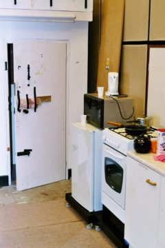 Studio 3 kitchen area with backdoor set into stairs MF